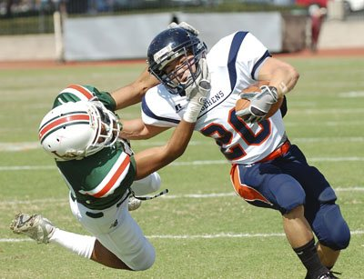 La Verne senior defensive back Grant Woods brings down Pomona-Pitzer running back Russell Oka early in the first quarter. The Leopards triumphed Saturday in their Homecoming game against the Sagehens, 45-37. / photo by Leah Heagy