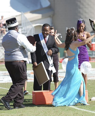 Surprise registers on the faces of Homecoming king Matthew White and queen Dionna Houston on Oct. 18 during the crowning ceremony at halftime. Last year's king Jonathan Smith and queen Stephanie Farrell offer their congratulations to the winners. / photo by Leah Heagy