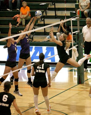 As La Verne sophomore Anna Calmer (No. 9) prepares to block a spike, Cal Lutheran sophomores Erin Exline (No. 4) and Megan Thorpe (No. 7) try to catch up with La Verne's one-point lead in the fourth set. The final score was 3-1, with the University of La Verne winning its 17th match this season. The Leopards' overall record now stands at 17-2 on the year. ULV plays tonight at Redlands at 7:30 p.m. and then again on Saturday at Occidental at 6 p.m. / photo by Christina Worley