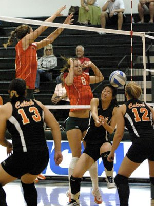 Caltech Beaver Vivian Yang (No. 2) shrinks from the ball delivered by Leopard Samantha McCosh (No. 8) during the third game at Frantz Athletic Court on Saturday. The match was short, lasting just a little more than an hour, with the Leopards sweeping Caltech, 3-0. / photo by Walter Mansilla
