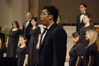 """The 10th Annual Friends Choral Festival included four high schools and the University of La Verne on Friday at the La Verne Church of the Brethren. Among the performances was tenor Michael Fausto, a ULV senior music/vocal performance major, who sang an arrangement of """"Loch Lomond"""" by Jonathan Quick. / photo by Walter Mansilla"""