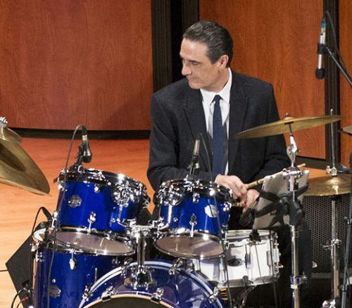 Steve Biondo plays drums in 2014 in Morgan Auditorium with the jazz group OrganiZm. Mr. Biondo died April 13 at the age of 58. A memorial service to remember his life was held on this same stage Wednesday. Students, faculty and friends held a jam session in his honor. / file photo by Julian Burrell