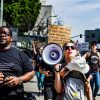 Thomas Allison and his wife, Brittany Allison, president and vice-president of the SJAP, march with the people who showed up to their organized protest. The Allisons seek to empower through inspirational dialogues and organizing.