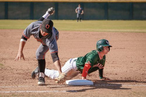 Occidental Tigers' junior first baseman Jeff Oki attempts to tag out La Verne junior secondbaseman Andrew Douglas, who is called safe, in the third inning Friday. Senior catcher Dylan Lowenstein smacked a walk-off double to score sophomore leftfielder Brandon Vogel in the 10th inning to give the Leopards the win 5-4, over the Occidental Tigers at Ben Hines Field. / photo by Breanna Ulsh