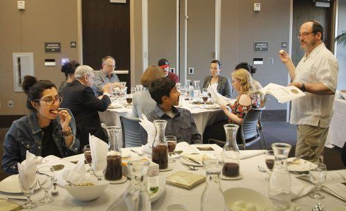 Paul Buch, cantor of Temple Beth Israel in Pomona, leads students, faculty and staff in a Model Seder April 5 in the Campus Center Ballroom. As part of the Passover tradition, Buch retold the deliverance of the Israelites from slavery in Ancient Egypt. / photo by Hannah Burton