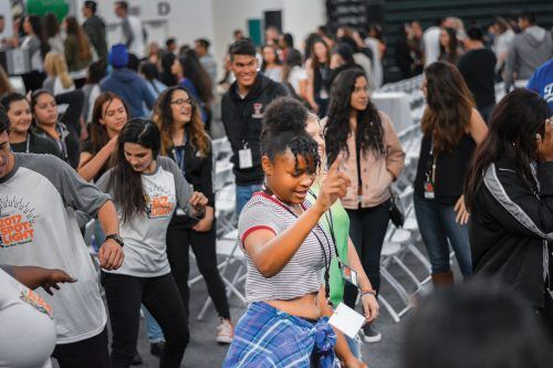 Admitted La Verne students Dallas Hall and Gillian Fugate dance the Wobble with their Spotlight group Saturday. The annual Spotlight Weekend event allows students, who have been accepted to the University, to tour the campus and interact with current students and other admitted students. Many prospective students also spent the night in dorms on campus. / photo by Conor Holahan