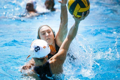 Senior attacker Zoe Kratzer blocks a shot from Occidental freshman utility Lori Berberian on Saturday at the La Verne Aquatics Center. The Leopards drowned the Tigers with a final score of 18-4. La Verne is 12-9 overall and will host the SCIAC Championships April 21-23. Photo by Cierra Boess