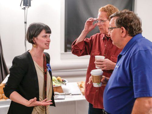 """Photographer Scout Tufankjian speaks to Senior Adjunct Journalism Professor Randy Miller and ULV Graphics General Manager Raffi Zinzalian during a reception in the Carlson Gallery following her lecture in Morgan Auditorium Tuesday. Her work is part of the gallery's exhibition """"Framing Armenia,"""" on display until May 26. / photo by Breanna Ulsh"""