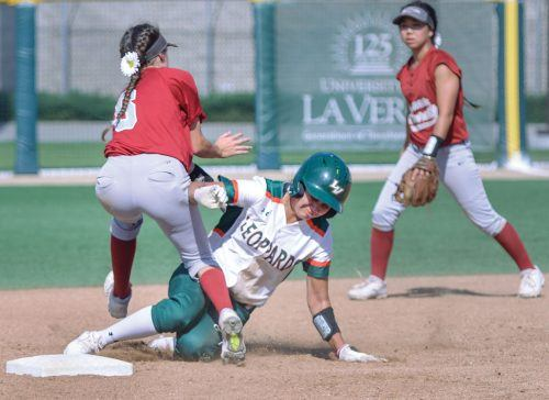 La Verne junior third baseman Haley Gomez attempts to steal second base during the bottom of the sixth inning of Saturday's second game against Chapman. Panther freshman infielder Michaela Foisy tagged her out, but the Leopards still managed to win, 4-0. The Leopards have an overall record of 25-9 and a 18-6 record in SCIAC play which is good for first place. / photo by Conor Holahan