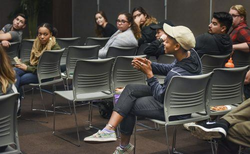 "Freshman anthropology major K'lema Burleson participates in a group activity during ""In her Shoes,"" a women's empowerment event Monday. Participants were grouped as men, women and gender fluid, then asked to tell the other groups something about themselves. This activity was designed to demonstrate listening and letting others know they've been heard. / photo by Alexandra Arkley"