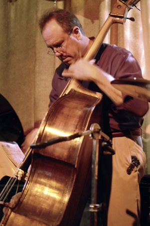 Bass player Chris Ferrin performs at the Hip Kitty Jazz and Fondue Club in Claremont on March 20, along with Nina Beck on piano, Andy Cowan on vocals and Scott Ikes on the drums. They will return to perform at the Hip Kitty on April 1. / photo by Leah Heagy