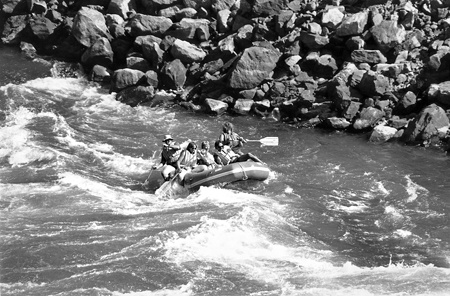 Like saddling up a wild Montana bronco, Roland Ortmayer, joined by daughter Susan, captains his raft through the Yankee Jim Canyon class three rapids on the Yellowstone River. The raft carries family members, including wife Cornelia. Coach Ortmayer would return most summers to Montana. He owned a cabin near the Bridger Bowl ski area but rarely stayed in it, preferring to travel widely throughout the state, floating its scenic rivers with his La Verne students and alumni friends and camping alongside them in his large trailer, followed by in the early 1990s, his motorhome. / file photo courtesy of University Archives