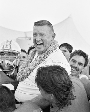 Ortmayer celebrates with his players after coaching his last game, a 37-7 win over Claremont on Nov. 10, 1990. / file photo by Eric Borer