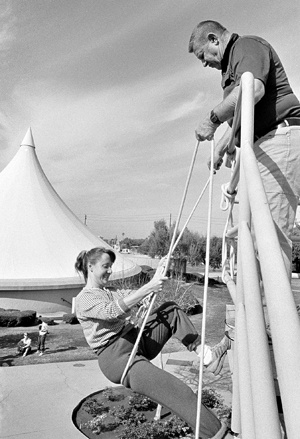 One of Ortmayer's popular classes was Climbing, where students such as Wendy Stevens rappelled down Miller Hall. A class highlight was a zip line set up from the top of the Mainiero Building to the middle of the football field. / file photo by Elaine Zukle