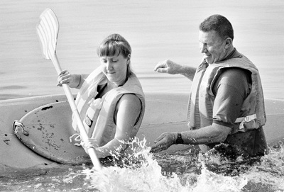 For several decades, Ortmayer taught a Small Watercraft class at Puddingstone Lake in Pomona. In this file photo from 1989, he teaches Wendy Stevens proper kayaking technique. / file photo by Elaine Zukle
