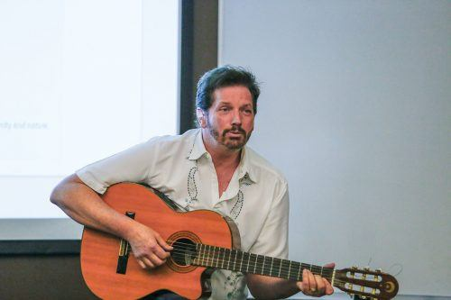 "Gary Mitchell, director of Planet Rehab in San Dimas, sings an original song about the environment. Mitchell also spoke about ""Understanding the Environmental Crisis of Costa Rica"" on April 27 in the Arts and Communication Building. Planet Rehab is an environmental conservation organization that utilizes music and other arts to raise awareness. / photo by Breanna Ulsh"