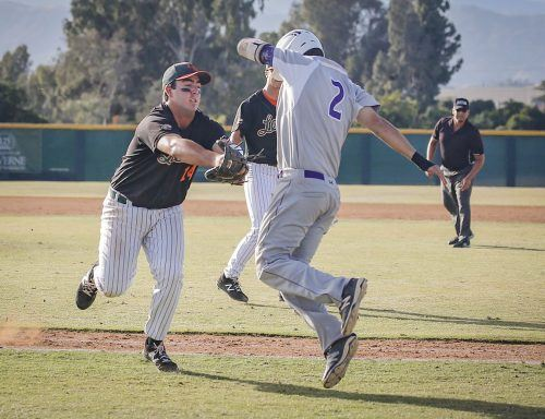 La Verne senior first baseman Jakob Thomas tags out Whittier junior second baseman Andrew Lamar on his way to first base during the eighth inning April 28. The Leopards chased down the Poets, 10-9, at Ben Hines Field, with four runs in the eighth inning./ photo by Megan Peralez