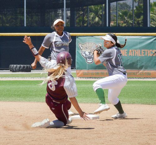 After tagging out Redlands senior third baseman Summer Smith, La Verne sophomore second baseman Michelle Deguzman throws the ball to first base for the double play in the top of the fifth inning Saturday. The final score was 8-0 at the end of six innings. / photo by Janelle Kluz