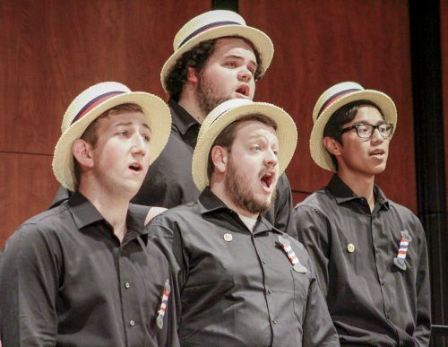 """Junior business administration major Dakota Zucconi, senior music major Terry Dopson, Mount San Antonio College student Mitchell Sampang and senior music major Garrison Holder perform for the """"125 Years of Barbershop"""" concert as part of the group Third Street Sound Sunday in Morgan Auditorium. / photo by Tyler Deacy"""