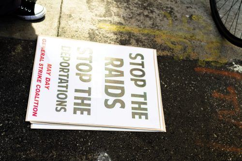 This style of sign, one of many that was handed out before the march began, was mass produced by the organizers of the protest. Upon arriving to the initial meeting point, organizers offered signs and flags to those who were empty-handed. Signs were also left on the ground for whoever wanted to pick them up to march with.