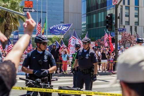 The scattered police line and two barriers separating the two sides that faced off for the rest of the afternoon until 5 p.m. Hate speech and hateful gestures were exchanged between the sides. Few people dared to cross the police line, only to be escorted away from the area and asked to either return to their side or stay away from the intersection.