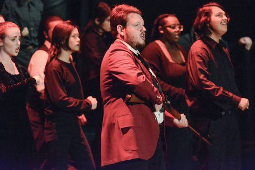 """Senior music major Terry Dopson performs as Enjolras in the song """"One Day More"""" from the play """"Les Misérables"""" at the University of La Verne Chorale and Chamber Singers' Broadway Showcase. The showcase took place in Dailey Theatre Friday and Saturday. The choir performed scenes from 12 Broadway musicals including """"Book of Mormon,"""" """"Rent,"""" """"Wicked"""" and """"Rock of Ages."""" / photo by Conor Holahan"""