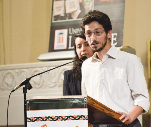 Graduate student Firas Arodaki and law student Yunuen Trujillo receive their Spirit of La Verne Awards Monday at the La Verne Church of the Brethren, making it the first year that the committee has recognized two recipients of the award. The Spirit of La Verne award is given to those who demonstrate two of the three core concepts of La Verne: community engagement, interfaith cooperation, and diversity and inclusivity. Arodaki advocates for Syrian refugees and Trujillo advocates for the inclusion of LGBT Catholics in their religious communities. / photo by Janelle Kluz