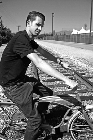 The University of La Verne's new head cross country coach Mike Atwood, hired in August, is not only a veteran runner but also an admirer of vintage bicycles. Perched upon his 1958 AMF Roadmaster, the 25-year-old coach is a recent graduate of Biola University, where he received a master's degree in education with an emphasis in classroom instruction. Although Atwood is new to ULV, he looks forward to growing with the students in the cross country program. Atwood will lead the Leopards' cross country teams tomorrow at the Riverside Invitational. / photo by Catherine Campos