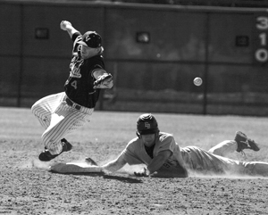 At the bottom of the eighth inning, center fielder Marc Tuttle of Cal State East Bay hit a double and was safe on a bad throw to second baseman Trevor Boucher. The Leopards played a doubleheader on Saturday against the Pioneers, losing the first game, 9-4, and winning the second, 14-6. La Verne will host a doubleheader against Texas Lutheran today at Ben Hines Field. / photo by Rhiannon MIm