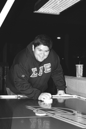 Showing no signs of tiring in his third round of air hockey, Joe Juarez won every round against his fraternity brother Jesur Habek. As part of Welcome Back Week, the Campus Activities Board hosted students at Boomers in Upland Sept. 6. Arcade games, miniature and cosmic golf, bumper boats, go-karts and rock climbing were all free of charge for ULV students. The event provided an opportunity for students to hang out and have some fun. / photo by Courtney Droke