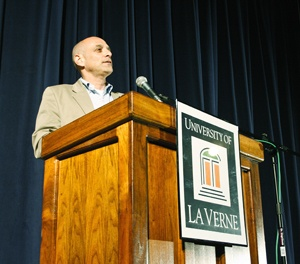 "As a writer and investigative journalist, Eric Schlosser has researched and written about fast food and the American black market. Schlosser's well-known book, ""Fast Food Nation: The Dark Side of the All-American Meal,"" was published in 2001. Schlosser was a guest speaker sponsored by the Office of Student Life, Campus Activities Board and ASULV at the University of La Verne on Monday. Schlosser spoke to a full house in Founders Auditorium. He encouraged everyone in attendance to continue their education because, he said, ""knowledge is power."" / photo by Catherine Campos"