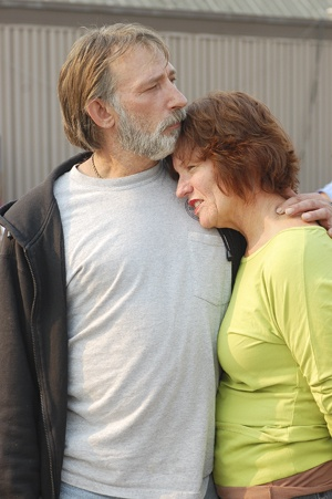 Gayle Fey and Gary Wilson share a moment as they stand outside the evacuation center in San Bernardino. The couple live in Rim Forest, a small town on the outskirts of Lake Arrowhead in the San Bernardino Mountains. Fey and Wilson have been evacuated since Tuesday, and have been staying in the shelter located in the Orange Show Pavilion. Fey and Wilson are two of many away from their homes. / photo by Leah Heagy
