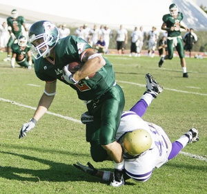 The University of La Verne football team fell to Whittier during the Homecoming game Saturday. Wide receiver Ryan Cofflet made a gain of two yards towards the end of the fourth quarter, before being tackled by the Poets' Brett Barstow. The Leopards lost 31-28, with a final 59-yard field goal attempt in the last few seconds of the game. La Verne's overall record now stands at 0-6. ULV will play at Redlands tomorrow at 1 p.m. before returning home to play Claremont-Mudd-Scripps the following week. / photo by Rhiannon Mim