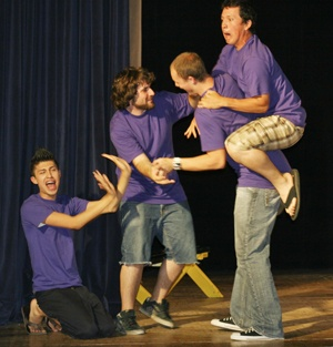 Sigma Alpha Epsilon members Paul Gamst, Matt Izaguirre, Kevin Claeys and David Contreras act out the same scene in different film genres suggested by the audience as part of SAE's Comedy Night. Members of the SAE fraternity competed in improv games against each other in Founders Auditorium on Tuesday. / photo by Lauren Pollard