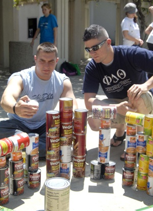 """In celebration of Earth Day, the fraternities and sororities on the University of La Verne campus took part in a competition to arrange food cans in the shape of well know artworks for Greek Week points. Ben Paine and James Ridings, members of the Phi Delta Theta, were attempting to recreate Henri Matisse's """"The Dance,"""" but received sixth place. / photo by Sher Porter"""