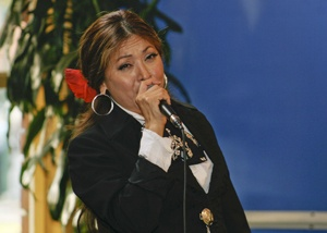 Eleana Garcia, vocalist for mariachi band Ellas Son, serenaded students eating dinner in Davenport Dining Hall on Monday in celebration of the life of César Chávez. The aroma of traditional Mexican food filled the air as students enjoyed the music. / photo by Lauren Pollard
