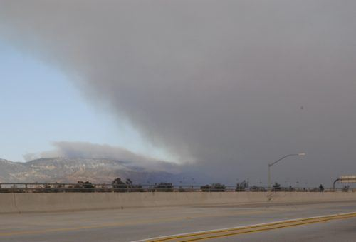 Smoke from the San Bernardino fires is visible from Fontana above the 210 Freeway. / photo by Leah Heagy