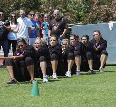 After winning the Greek Week Tug-of-War last year, the women of Sigma Kappa tried to defend their title on April 24. Weighing a total of 980 pounds, Jessica Vergara, Kristin Harper, Amanda Santos, Kelli Nottingham, Chrissy Siriani, Danielle Rodriguez, and Patty Allen were defeated by Phi Delta Theta. / photo by Jaclyn Dino