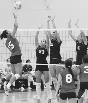 In the third game of the NCAA West Region semifinal match, La Verne's Jodi Lindsay, Ashley Morgado and Crista Jones attempt to keep Cal State East Bay's Jackie Randolph from scoring a point for her team Nov. 9 at the Pioneer Gym in Hayward. The Leopards went on to beat the Pioneers, 3-2, bringing them to a 27-6 record. ULV advanced to the West Region finals, where they fell to the Puget Sound Loggers, 3-2. / photo by Courtney Droke