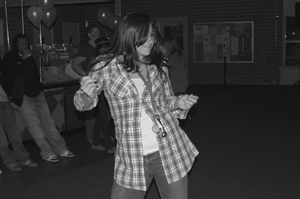 Students gathered in Davenport, on Nov. 27 for the final dance of the demester. It was a Western Dance hosted by the Campus Activities Board. Trisha McCormick, a junior enjoyed the beats of DJ Kamikazee, who drove down from Santa Clarita to mix the music. / photo by Jaclyn Dino
