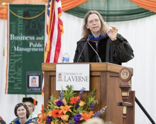 The La Verne community came together Aug. 30 for Convocation, signaling the start of a new school year. David Chappell, associate professor of physics, was Convocation speaker for the event held in the Athletics Pavilion. Chappell, who earned the 2017 Excellence in Teaching Award, talked about viewing last month's eclipse from his family's farm, which fell in the path of the totality. / photo by Taylor Griffith