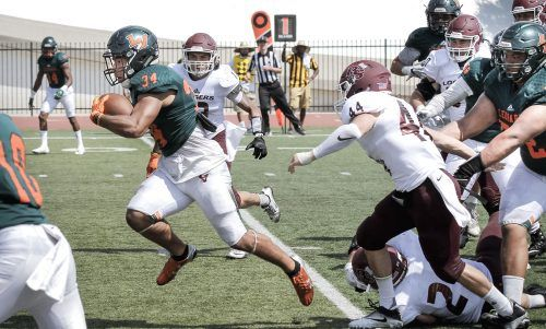 La Verne senior running back Robert Fernandez advances the ball against Puget Sound at the end of the second quarter Saturday at Ortmayer Stadium. The temperature was already in triple digits by 1 p.m. when the game began. The Leopards took and held an early lead despite a late game rally by the Loggers. In the end, the Leopards felled the Loggers with a final score of 33-25. / photo by Spencer Croce