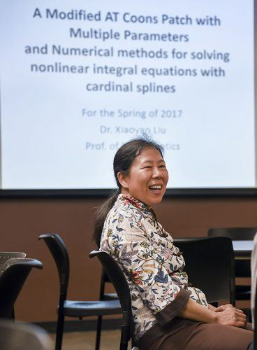 """Xiaoyan Liu, professor of mathematics, has more than 30 publications of her research. This summer Liu traveled to London and China to speak on her recently published work, """"A Modified AT Coons Patch with Multiple Parameters."""" Liu explained how approximation theory can benefit companies during her lecture Tuesday in the President's Dining Room. / photo by Cortney Mace"""