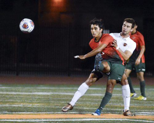 Senior midfielder Javier Jasso intercepts a Bearcat pass during the second half of the men's soccer game against Willamette. The Leopards lacerated the Bearcats, 3-0, Monday night at Ortmayer Stadium. This was La Verne's last friendly game before conference play. / photo by Dorothy Gartsman