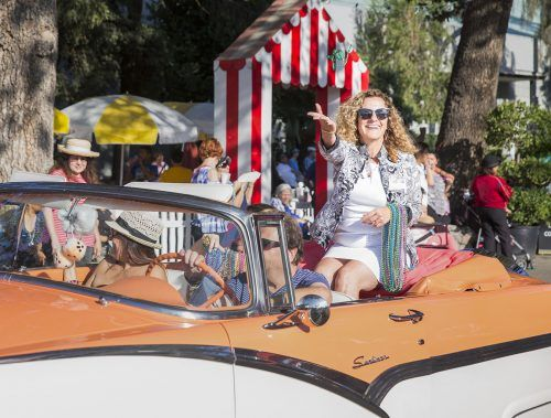 University of La Verne President Devorah Liberman rides in the back of a 1956 Ford Sunliner in the La Verne Community Day parade Wednesday at the Los Angeles County Fair in Pomona. The procession included community members, students,veterans and local dignitaries. The Los Angeles County Fair is open Wednesday through Friday beginning at noon and Saturdays and Sundays starting at 10 a.m. through Sept. 24. The fair offers rides, fried foods and even a petting zoo./ photo by Taylor Griffith