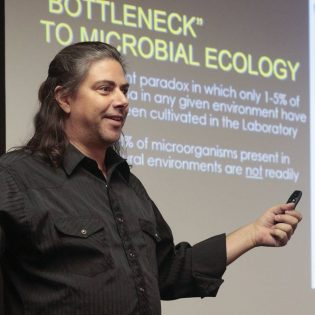 """Todd Lorenz, assistant professor of biology, presents his research on bacteria Tuesday in the President's Dining Room. Lorenz's presentation titled """"Cultivation of Chitinolytic Bacteria and the Design of Bioprospecting Tools"""" was part of the weekly La Verne Academy lecture series, held Tuesdays at noon. Professors Vanessa Preisler and Ricardo Morales will present, """"Faraday Rotation of Magnetic Nanoparticles"""" at noon Tuesday. / photo by Celeste Drake"""