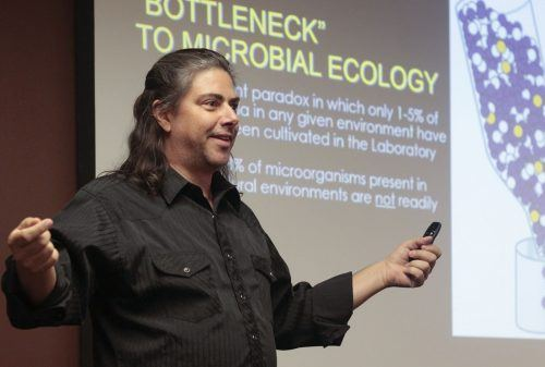 "Todd Lorenz, assistant professor of biology, presents his research on bacteria Tuesday in the President's Dining Room. Lorenz's presentation titled ""Cultivation of Chitinolytic Bacteria and the Design of Bioprospecting Tools"" was part of the weekly La Verne Academy lecture series, held Tuesdays at noon. Professors Vanessa Preisler and Ricardo Morales will present, ""Faraday Rotation of Magnetic Nanoparticles"" at noon Tuesday. / photo by Celeste Drake"