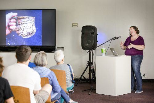 Ceramicist Jillian O'Dwyer speaks at the American Museum of Ceramic Art in Pomona Sept. 21. She uses objects she finds to leave imprints of recognizable forms on her ceramic pieces. She then paints and glazes them to highlight certain areas in the material. / photo by Taylor Griffith