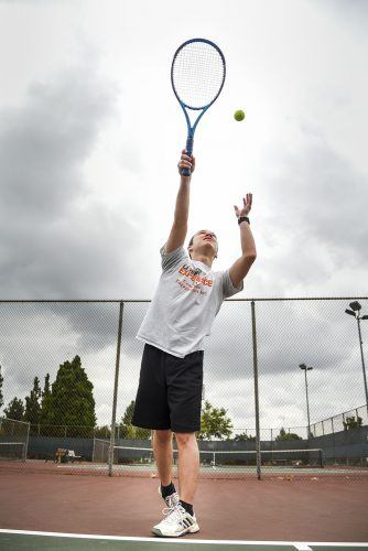 Tennis Club Vice President Matthew Allison practices his serves last month at Las Flores Park. Allison and club president Ivan Fernandez started the tennis club to keep the game alive at La Verne after the intercollegiate men's and women's teams were canceled at La Verne, in 2009 and 2016 respectively. / photo by Cortney Mace