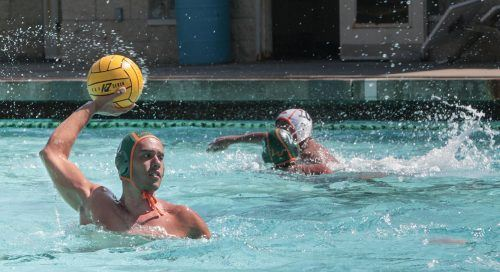 Junior center Mike Meza passes the ball to an open teammate during the men's water polo game against Caltech Saturday at the La Verne Aquatic Center. The Leopards drowned the Beavers, 17-7 but lost against Claremont-Mudd-Scripps Wednesday night. / photo by Celeste Drake